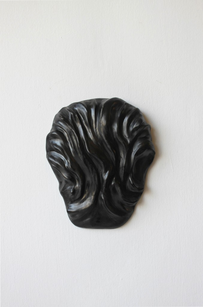 Lea Avital, Head, version 2, Plaster and ink, 22x15x5cm, 2007