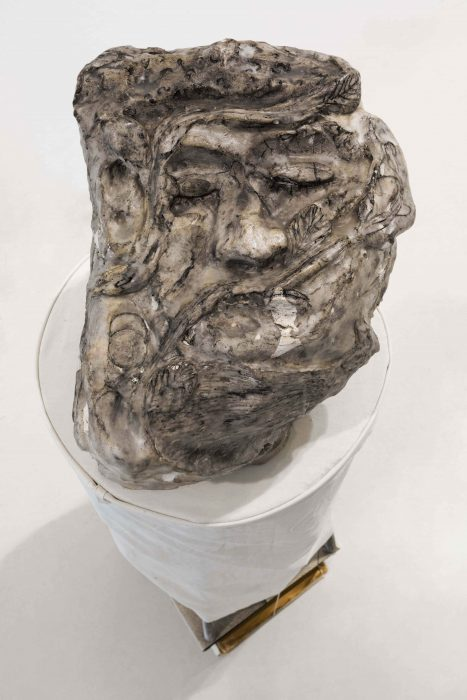 sleeping smoker Head, 2018, white cement, coal and wax, 27x22x30cm